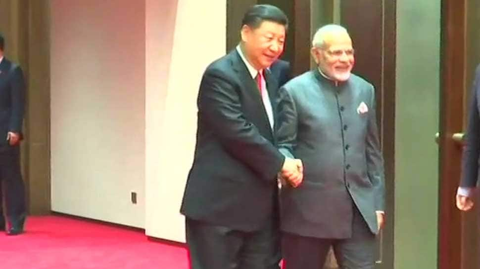 In Qingdao, China's Xi Jinping greets PM Narendra Modi with a handshake and smile ahead of SCO Summit
