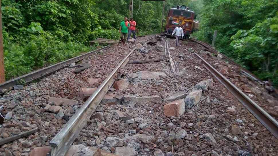 Goods train wagons fall off bridge after Naxals uproot tracks