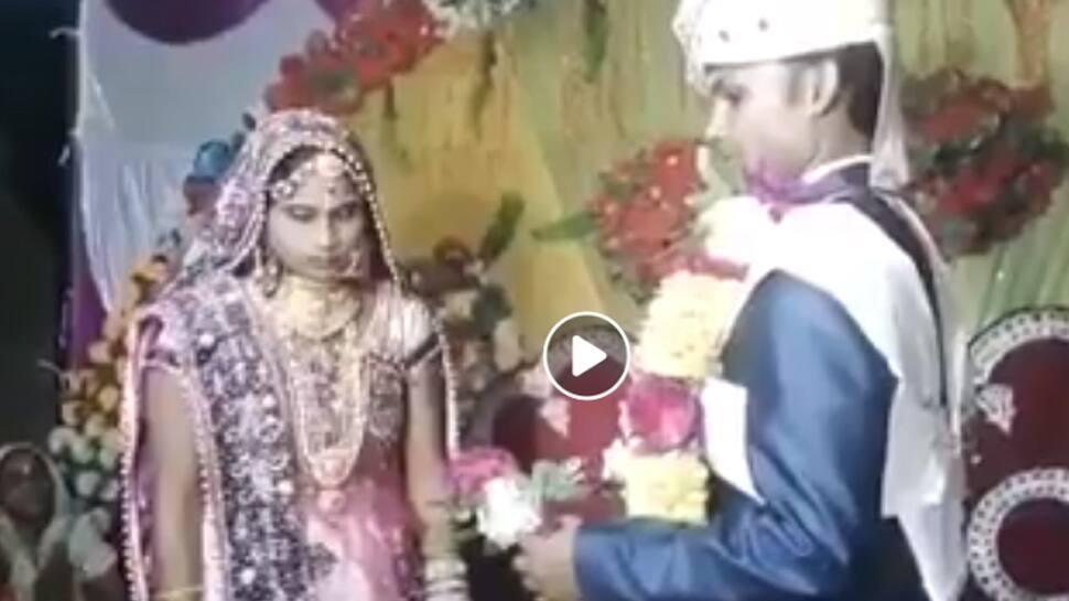 Groom 'throws' garland around bride's neck in the most hilarious way—Watch