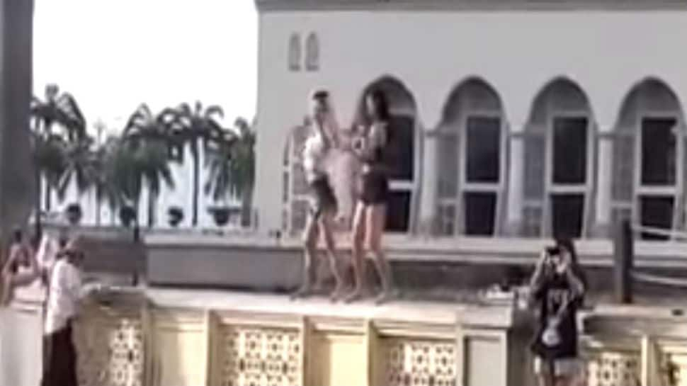 Malaysia throws out Chinese women tourists for dancing outside mosque