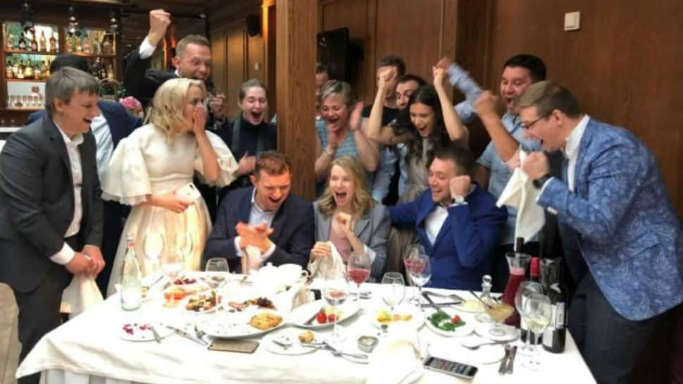 Russian couple stops wedding to watch home team knock Spain out of FIFA World Cup 2018