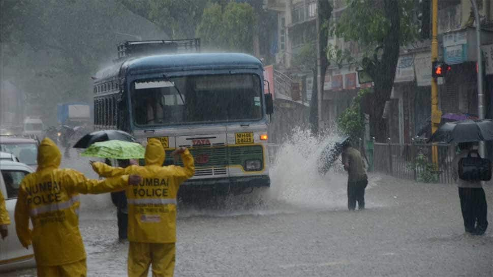Mumbai rain continues to affect city, local trains running late: Live updates