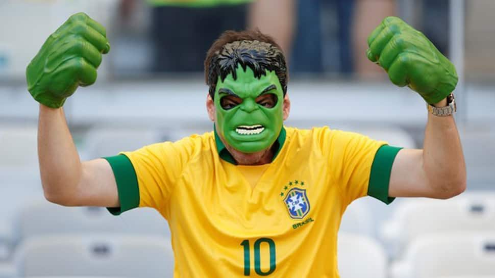 Brazil welcomed by a song and dance carnival; Belgium train for Kazan clash