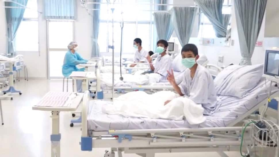 Watch: Staff gets emotional as rescued Thai Boys wave and smile from hospital beds