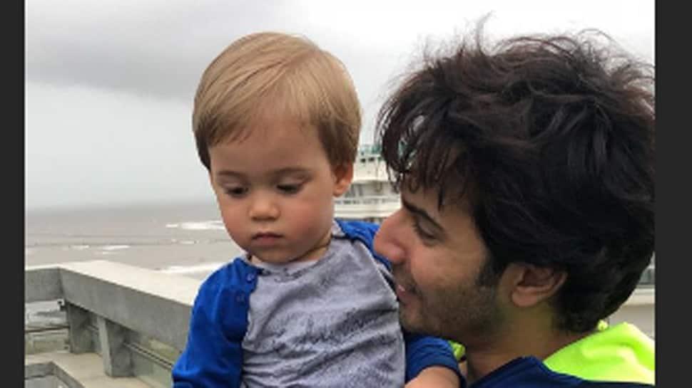 Karan Johar shares adorable picture of son Yash with Varun Dhawan
