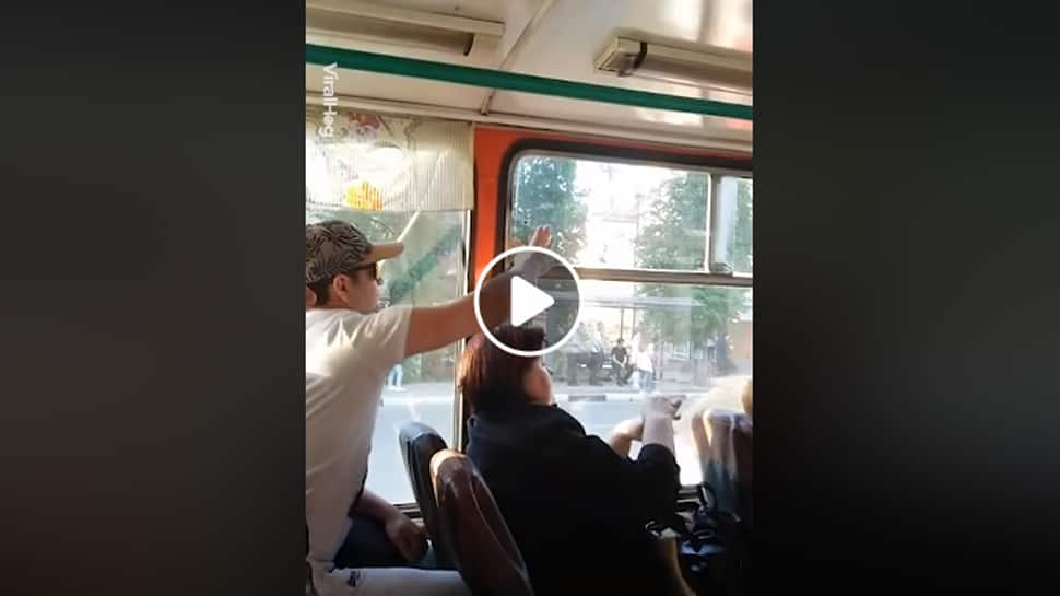 A silent and non-aggressive argument over bus window - Watch