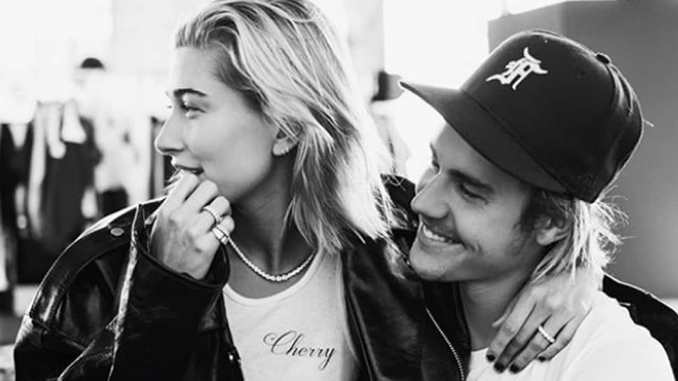 Justin Bieber shares a passionate kiss in the pool with fiance Hailey Baldwin—Pic