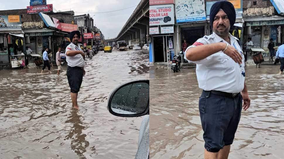 Gul Panag tweets photos of traffic policemen working in pouring rain, Punjab CM promises reward