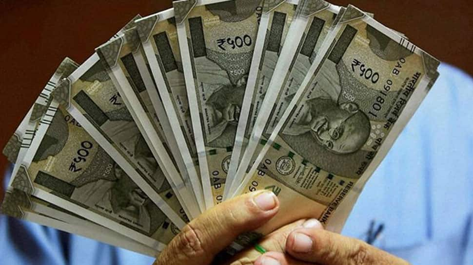 Rupee slips 43 paisa to end at life-time low of 69.05 against dollar