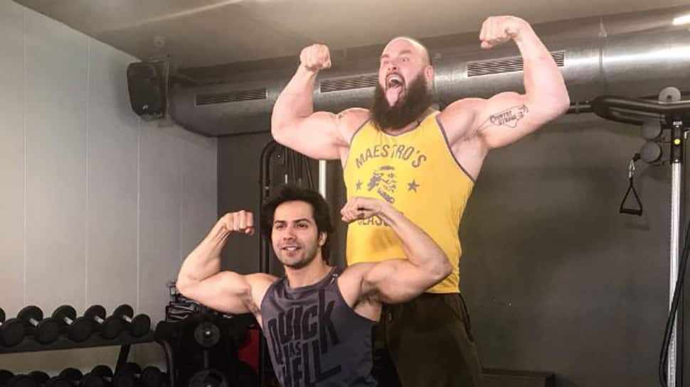 Varun Dhawan got into a 'muscle flexing contest' with WWE monster Braun Strowman. Guess who won?