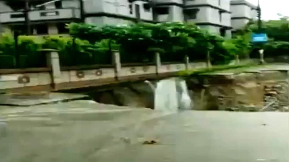 'Waterfall' in Vasundhara near Delhi after road caves in - Watch