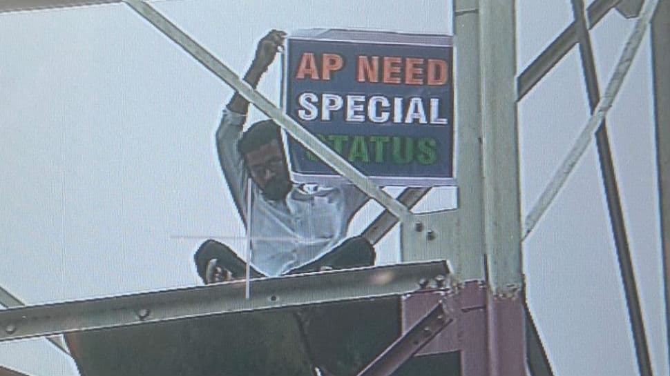 Man climbs tower near Delhi's Metro Bhawan to demand special status for AP
