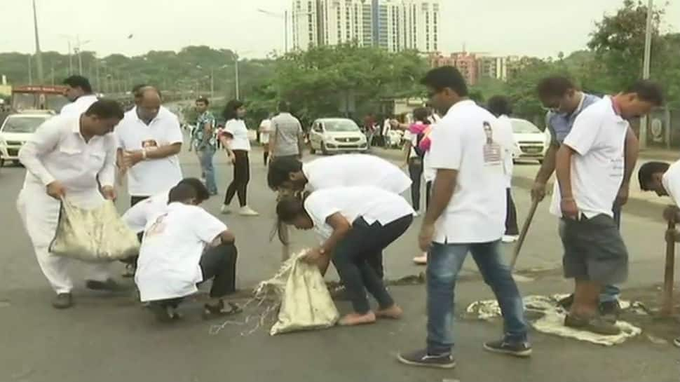 Mumbai man fills potholes for three years after losing son to road accident