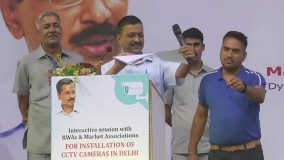 Arvind Kejriwal, on stage, rips LG's report on CCTV cameras
