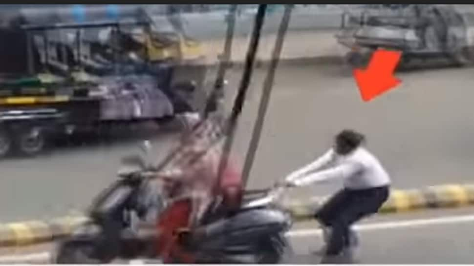 Watch: Woman constable holds on to speeding two-wheeler to catch errant female rider in Rajkot