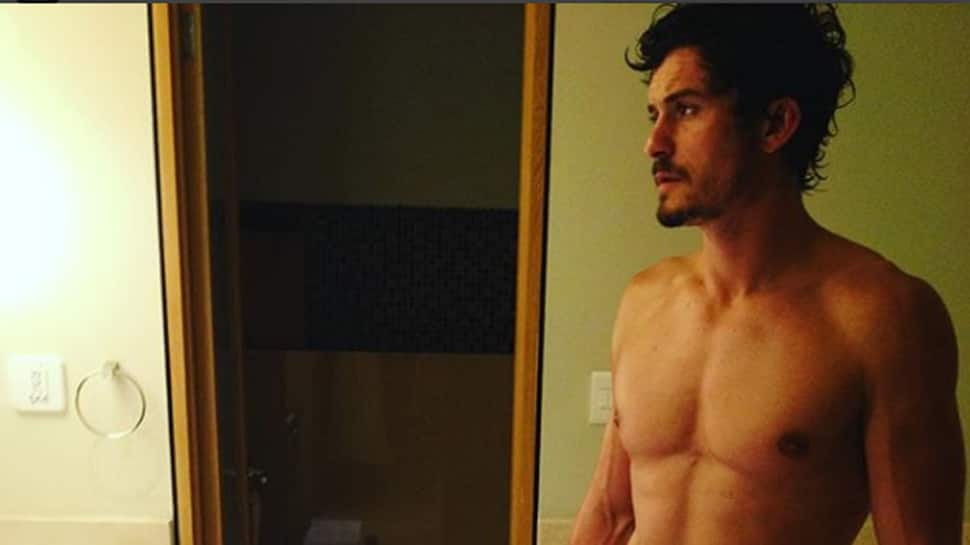 Orlando Bloom strips down in bathroom video as he escapes gigantic spider