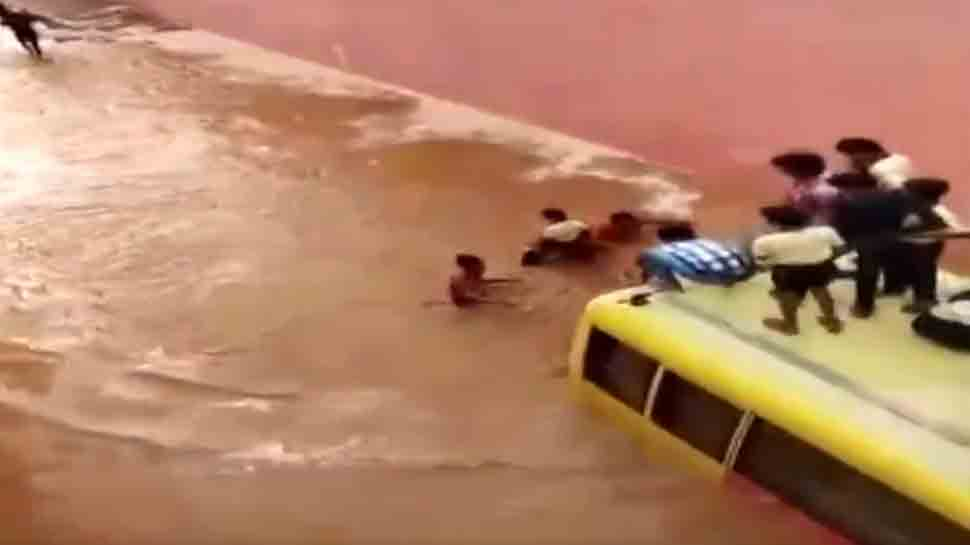 Bus carrying school students submerges in flooded road in Rajasthan — Watch