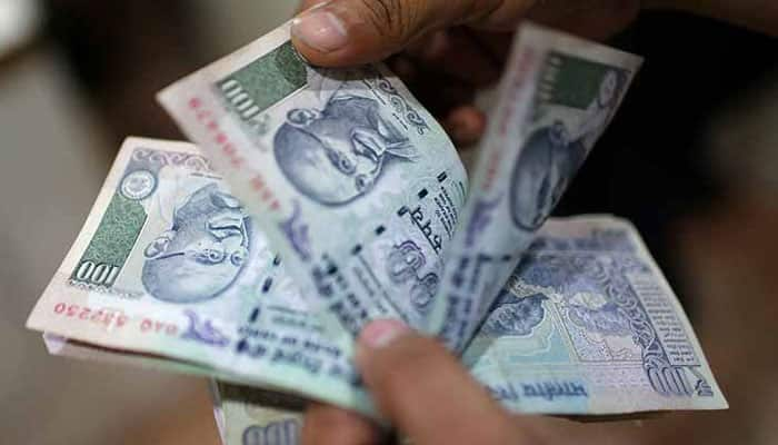 Rupee opens at fresh record low
