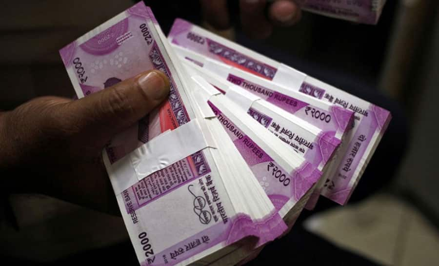 Rupee closes at record low of 72.69 against dollar