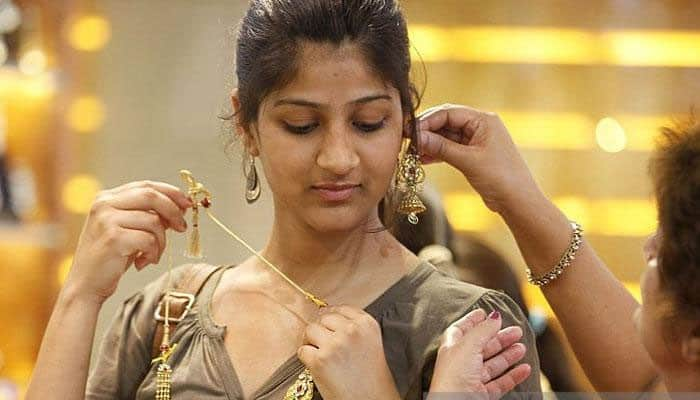 Gold eases on muted demand; weak global cues