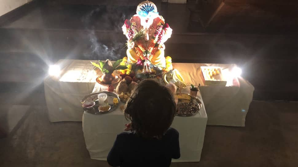 Shah Rukh Khan's son AbRam praying to Lord Ganesha is too cute for words—Pic