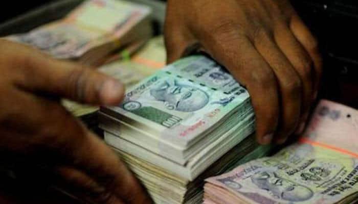 Rupee ends slightly higher at 72.37 against dollar