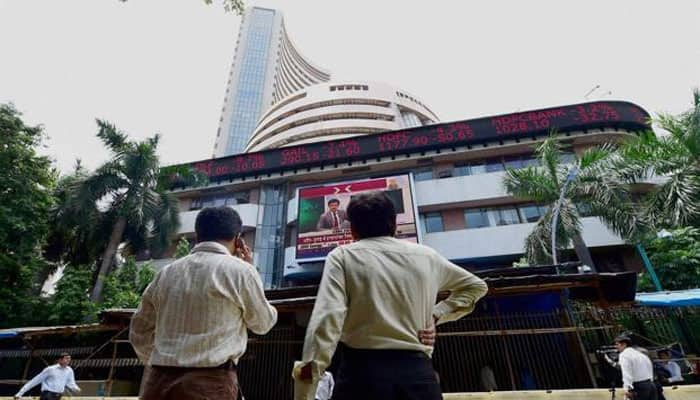 Sensex falls nearly 100 points, Nifty closes below 11,000