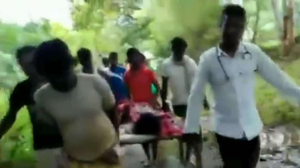 Odisha: Locals carry patient on cot due to lack of proper roads