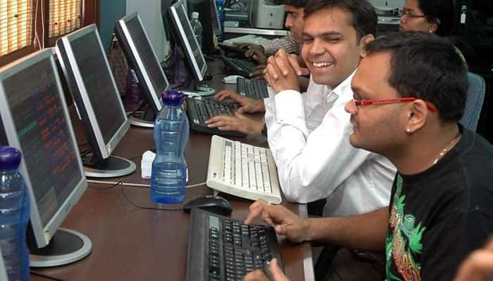 Sensex jumps nearly 300 points, Nifty closes above 11,000