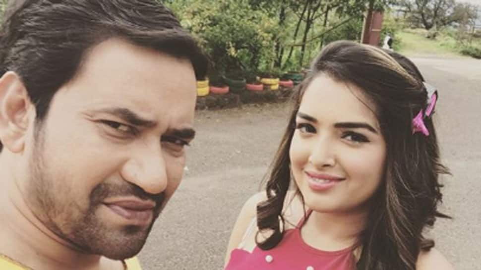 Amrapali Dubey's fan shares throwback pic of the actress with Dinesh Lal Yadav Nirahua