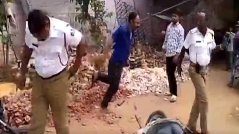 Watch: Drunk man arrested for thrashing cops in Karnataka's Davangere