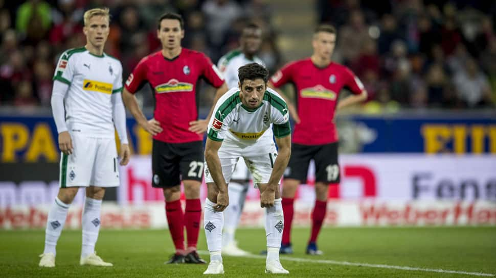 Borussia Mönchengladbach miss chance to go top after 3-1 loss at Freiburg