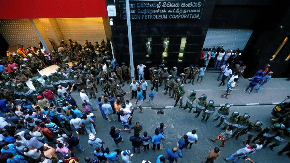 Guard opens fire, killing 1 in Sri Lanka at sacked PM Ranil Wickremesinghe office