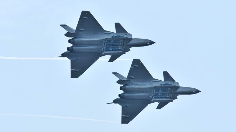 China flexes muscles, shows J-20 jet's missiles for the first time at airshow