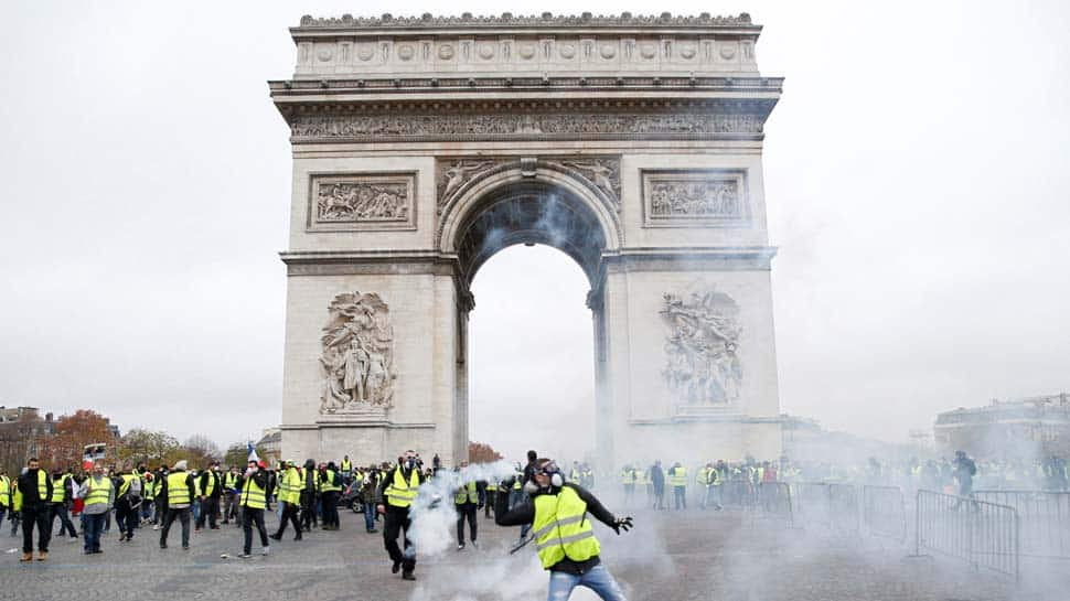 France mulls state of emergency after Paris riots, won't change policy