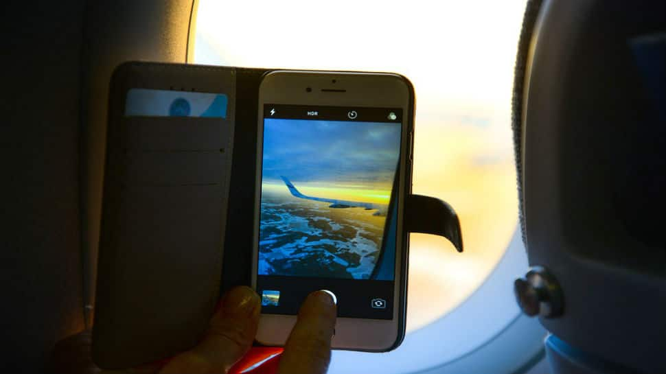 Permission to make in-flight calls, surf web likely by January
