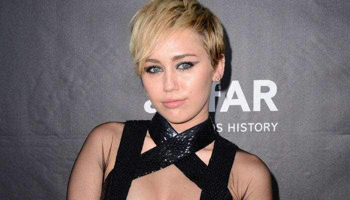Miley Cyrus sends cat emoji to Grande after split with Davidson