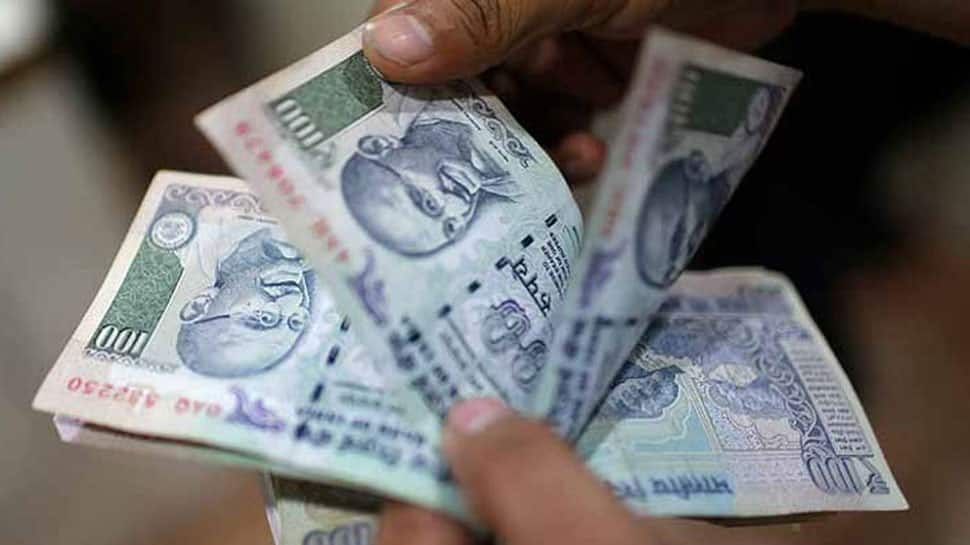 Rupee recovers 34 paise to 69.86 against US dollar in morning trade