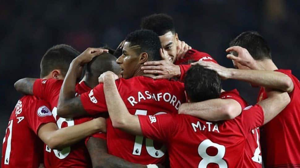 Manchester United beat Reading 2-0 to make FA Cup progress, Chelsea through