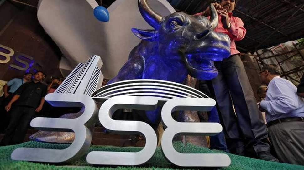 Sensex builds on gains; Nifty claims 10,800 mark