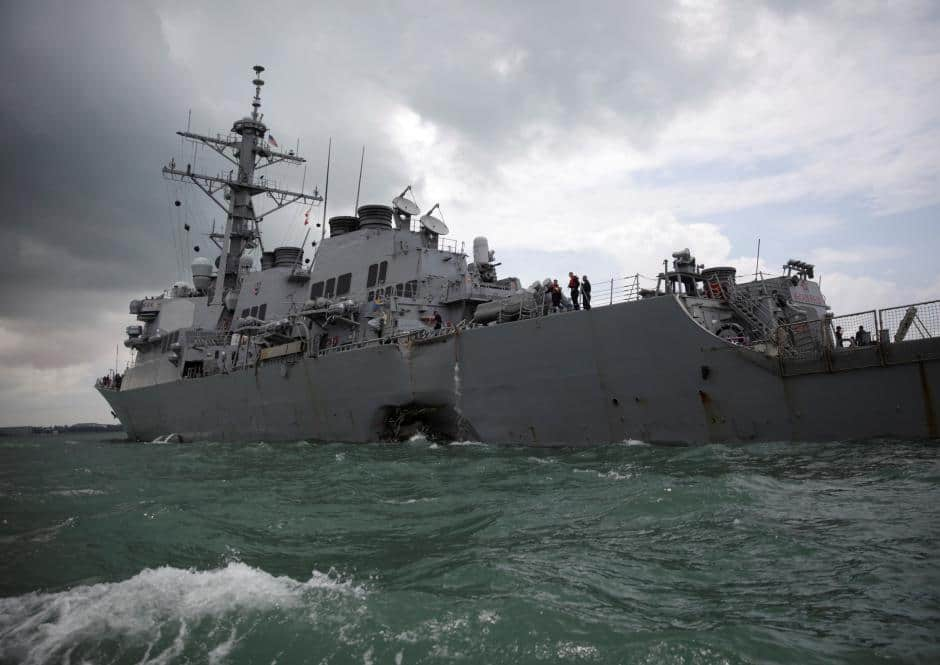 US navy ship sails in disputed South China Sea amid trade talks with Beijing