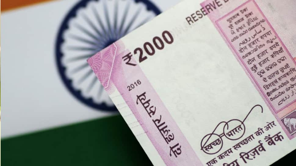 Rupee may take another bruising this year but no new record low: Poll
