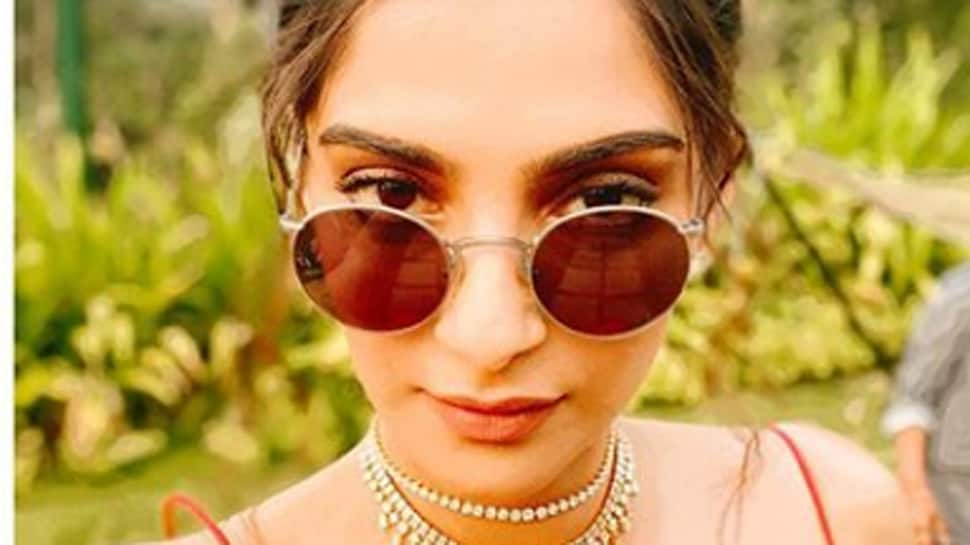 Sonam Kapoor gives style inspiration with a deep-neck tangerine dress—Pics