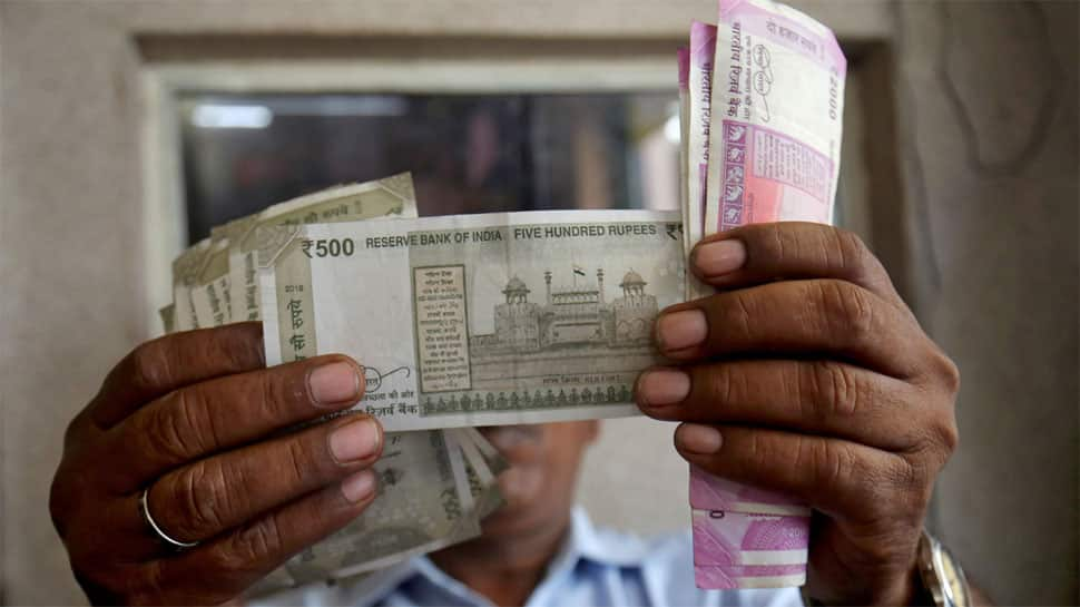 Rupee breaches 71 per dollar on ''chunky outflows''