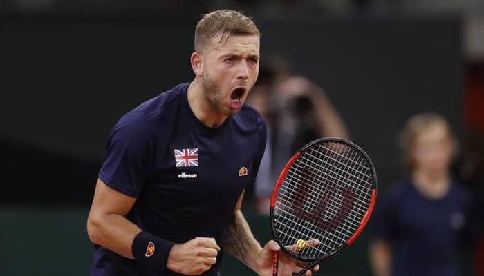 Australian Open: Dan Evans shoulders slim British hopes against Roger Federer