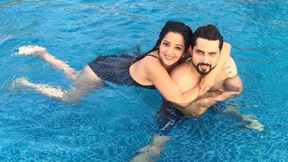 Monalisa sizzles in a black swimsuit, enjoys pool time with hubby Vikrant Singh – See pics