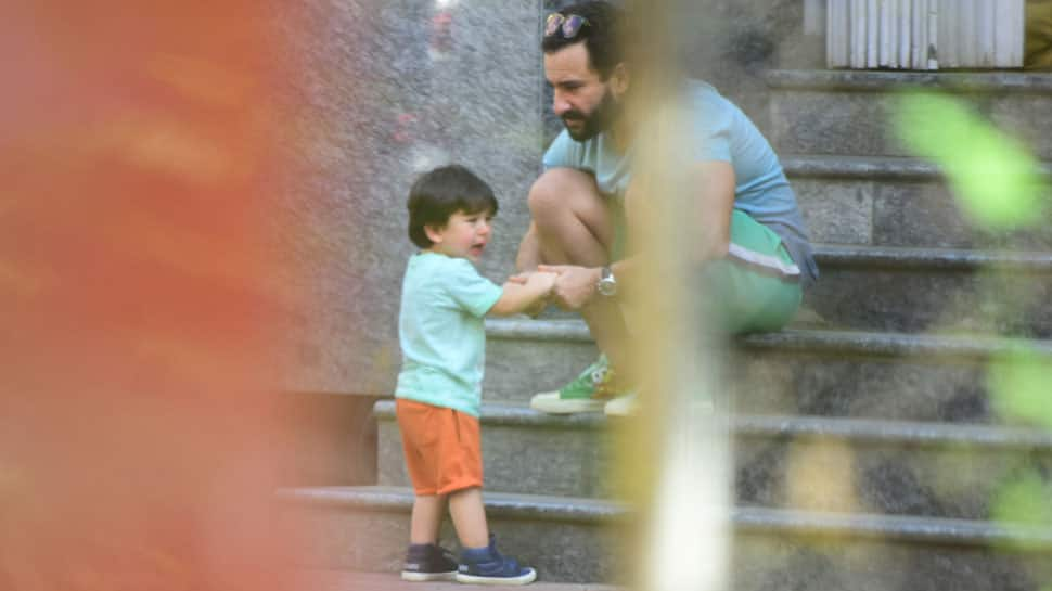 What is it that Taimur wants from daddy cool Saif Ali Khan in these pics?