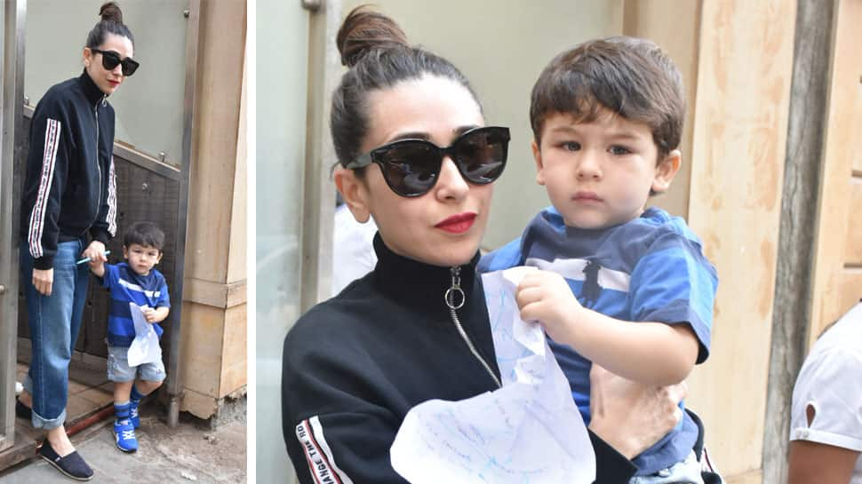 Taimur Ali Khan steps out with aunt Karisma Kapoor, plays with pen and paper - See Pics