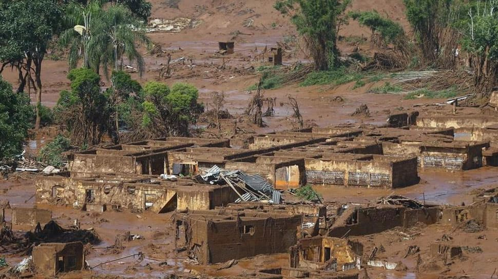 Seven bodies found after dam burst at Brazil mine, hundreds missing