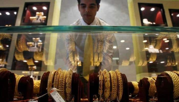 Gold gains Rs 340 to Rs 34,45 per 10 gm on local demand